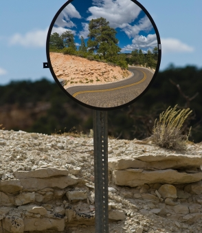 Hindsight Bias. Looking at the road behind you from the front mirror.